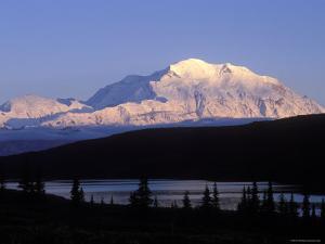 Midnight Alpenglow on Mount Mckinley Reflecting in Wonder Lake, Alaska by Rich Reid