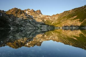 Sunrise on the Sierra Buttes Reflecting in Glassy Upper Sardine Lake by Rich Reid