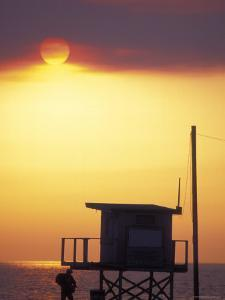 Sunset During the Malibu Fires; Silhouette of Lifeguard Stand, California by Rich Reid