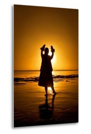 A Hula Dancer in Silhouette Along the Shoreline at Low Tide on Molokai Island