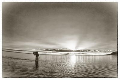 A Woman Walking in Tidal Flats in Front of Molokai South Shore Line by Richard A. Cooke Iii.
