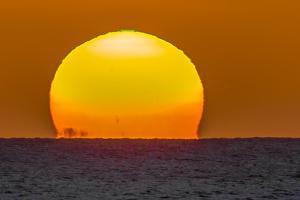 Sun Setting into the Pacific Ocean from Kamalo Wharf, Molokai, Hawaii by Richard A Cooke III