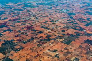 An Aerial View of Massive Farmland with Pivot Irrigation Crop Circles. by Richard A McMillin