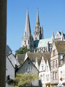 Spires of Notre Dame Cathedral, and Old Town, Chartres, Centre Val De Loire, France by Richard Ashworth
