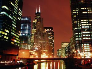 Chicago River and Downtown Buildings at Night, Chicago, United States of America by Richard Cummins