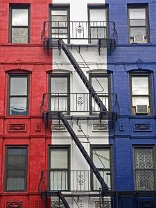 Red, White, and Blue Apartment Building by Richard Cummins