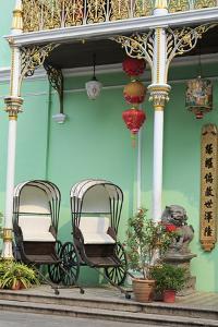 Rickshaws in Pinang Peranakan Mansion, Georgetown, Penang Island, Malaysia, Southeast Asia, Asia by Richard Cummins