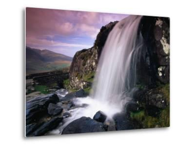 Waterfall and Jagged Rocks in the Irish Countryside