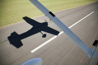 A Cessna Light Aircraft Taking Off. the Shadow Tells the Story.