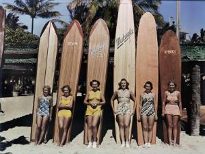 Women Pose in Front of their Surfboards on Waikiki Beach by Richard Hewitt Stewart