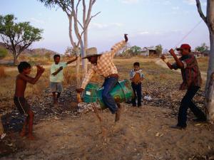 Boys Practising Rodeo Skills on 44 Gallon Drum, Kimberley, Western Australia, Australia by Richard I'Anson