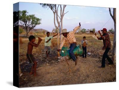 Boys Practising Rodeo Skills on 44 Gallon Drum, Kimberley, Western Australia, Australia