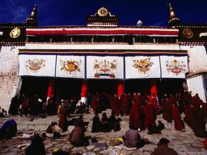 Monks and Pilgrims Outside Sera Monastery, Lhasa, Tibet by Richard I'Anson