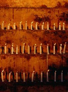 Rows of Candles at Mahabodhi Temple, Bodhgaya, Bihar, India by Richard I'Anson