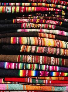 Stack of Woven Cloth, La Paz, Bolivia by Richard I'Anson