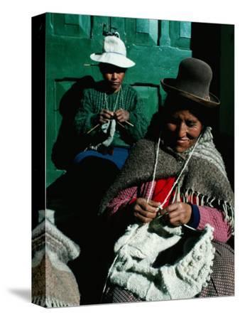 Women in Hats, Knitting Outside in the Sunshine, by a Green Wooden Door, Peru