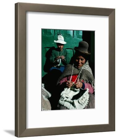 Women in Hats, Knitting Outside in the Sunshine, by a Green Wooden Door, Peru