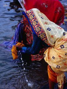 Women Washing Saris at Man Mandir Ghat, Varanasi, Uttar Pradesh, India by Richard I'Anson