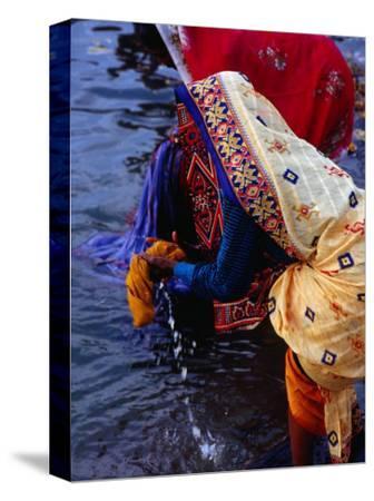 Women Washing Saris at Man Mandir Ghat, Varanasi, Uttar Pradesh, India