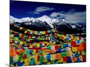 Meilixueshan (Also known as Meili Xueshan) Mountain Range and Buddhist Prayer Flags by Richard l'Anson