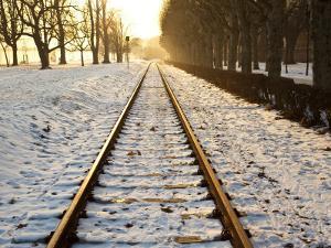 Train Tracks in Snow in Winter by Richard l'Anson