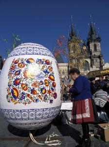 A Moravian Woman Decorating a Large Egg with Easter Designs on the Old Town Square, Prague by Richard Nebesky