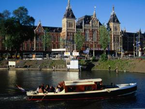 Boat in Front of Centraal Station, Amsterdam, Netherlands by Richard Nebesky
