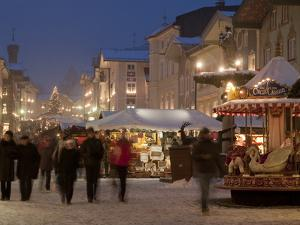Christmas Market Stalls and People at Marktstrasse at Twilight, Bad Tolz Spa Town, Bavaria, Germany by Richard Nebesky