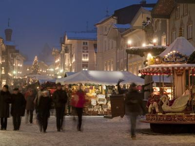 Christmas Market Stalls and People at Marktstrasse at Twilight, Bad Tolz Spa Town, Bavaria, Germany
