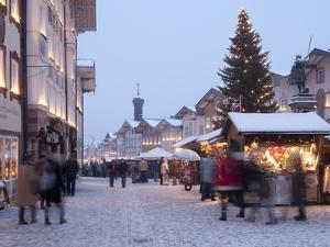 Christmas Tree With Stalls and People at Marktstrasse in the Spa Town of Bad Tolz, Bavaria by Richard Nebesky