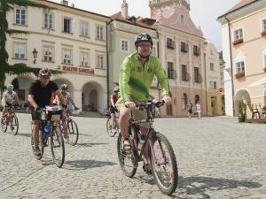 Cyclists Riding Through Namesti in Town of Mikulov, Brnensko Region by Richard Nebesky