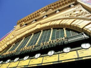 Facade of Front of Flinders Street Station with Clocks Showing Department of Next Train, Victoria by Richard Nebesky