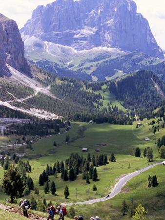 Hikers on Alta Via Dolomiti Trail and Gardena Pass Below and Sassolungo Range 3181M, Alto Adige
