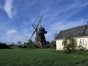 Landscape with Wooden Windmill and Two Houses in the Village of Kvarnbacken, Oland Island, Sweden by Richard Nebesky