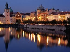 Lights Reflecting on Vltava River at Smetanova Embankment, Prague, Czech Republic by Richard Nebesky