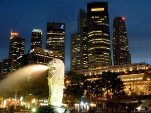 Merlion Fountain with Statue of Half Lion and Fish, with City Buildings Beyond, Southeast Asia by Richard Nebesky