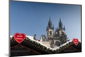 Merry Christmas Sign at Snow-Covered Christmas Market and Tyn Church by Richard Nebesky