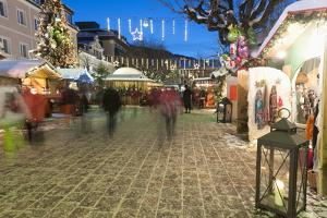 People at Christmas Market, Haupt Square, Schladming, Steiemark, Austria, Europe by Richard Nebesky