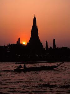 Silhouette of Wat Arun (Temple of the Dawn), at Sunset, on Banks of Chao Phraya River, Thailand by Richard Nebesky