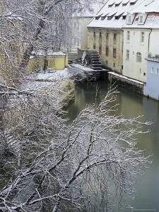 Snow-Covered Certovka Canal and Water Wheel at Kampa Island, Czech Republic, Europe by Richard Nebesky
