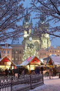 Snow-Covered Christmas Market and Tyn Church, Old Town Square, Prague, Czech Republic, Europe by Richard Nebesky