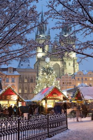 Snow-Covered Christmas Market and Tyn Church, Old Town Square, Prague, Czech Republic, Europe