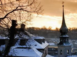 Snow-Covered Rooftops and Tower of Johann Am Imberg with Ridge of Monchsberg by Richard Nebesky