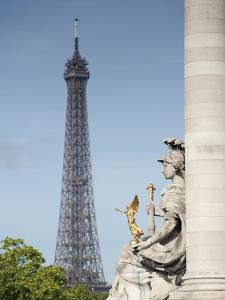 Statue on the Alexandre Iii Bridge and the Eiffel Tower, Paris, France, Europe by Richard Nebesky
