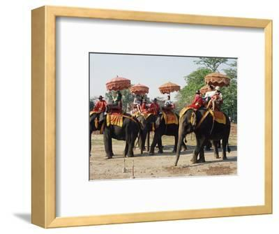 Tourists Riding Elephants in Traditional Royal Style, Ayuthaya, Thailand, Southeast Asia
