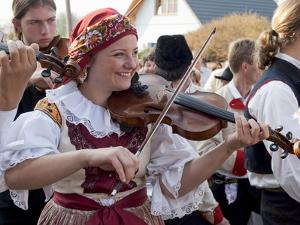 Woman Playing Violin and Wearing Folk Dress, Borsice, Brnensko, Czech Republic by Richard Nebesky