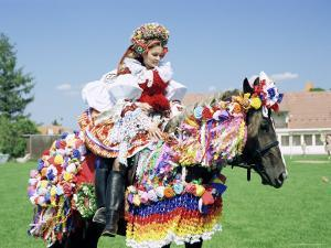 Young Woman Wearing Folk Dress on Horseback, Ride of the Kings Festival, Village of Vlcnov, Vlcnov by Richard Nebesky