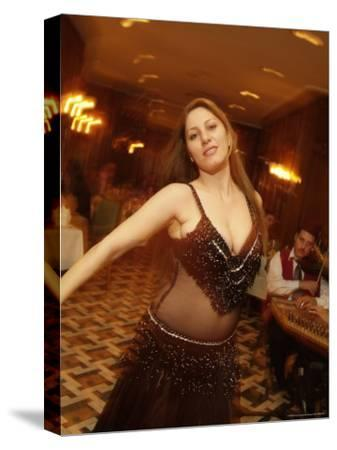 A Belly Dancer Entertains at the Sheraton Hotel Dinner Theater