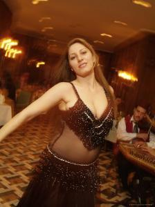 A Belly Dancer Entertains at the Sheraton Hotel Dinner Theater by Richard Nowitz