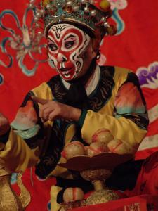 A Chinese Opera Performer in Monkey Makeup and Costume by Richard Nowitz